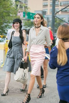 25 Cool Alexa Chung Outfits to Copy   pink pencil skirt, polka dot blouse and lace-up heels   Celebrity Street Style   @stylecaster (Sponsored)