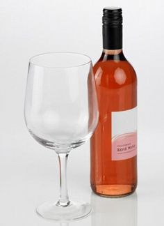 """Keep calm and carry a large glass!    """"Wine glass that can hold an entire bottle 'promotes heavier and irresponsible drinking' say doctors.""""     Buzzkill!"""
