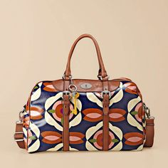 Fossil Key-Per Duffle weekender bag. Might need it for short business woman trips.  Wish it had wheels though.