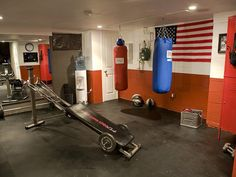 Awesome Rooms From Man Caves: This new home gym/man cave includes punching bags, weight equipment and a water cooler. The new rubber interlocking tiles look great and are perfect for a gym floor.  From DIYnetwork.com