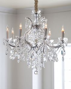 "Chandelier made of metal and glass. Dressed in myriad hand-cut crystals. Polished chrome finish. Uses nine 60-watt bulbs. Mounting hardware and 5.25""Dia. ceiling canopy included. Direct wire; assembly"