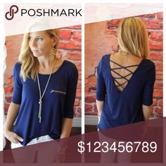 """Navy Cross-Back Top Super soft & stretchy (95% Rayon & 5% Spandex) navy cross-back 3/4 sleeve, high-low style top, adorned w/ a zipper pocket. Measures flat b4 stretch: pit2pit is 19""""W, length front is 24.75""""L/back is 28.5""""L. Goes perfect w/ spring skirts, shorts & jeans. EUC, washed & worn twice, no signs of wear❌no trades❌no holds. Any❓please ask prior 2 purchase😊 HeartHips Tops"""