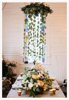 flower chandelier, glass jar chandelier hanging table decoration. Love the leaves from the crown of flowers
