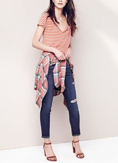 Pairing stripes with plaid for a bold statement.