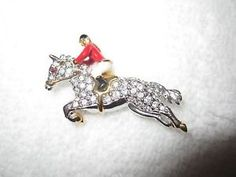 SOLD! Rare Joan Rivers Estate Jumping Horse & Rider Pin From Her Personal Jewelry Box Extremely rare! The English jumping horse and rider pin. Silver tone, with gold accents. Enameled and embellished with white crystals; red crystal for the eye. Wonderful detail!  One of almost 40 pins we bought at the Joan Rivers' estate auction--these were her favorite pins that she actually wore, from her personal jewelry box!