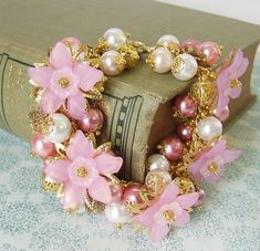 Flowers and pearls Charm Bracelet  Pretty in pink. Handcrafted by White Raven Designs