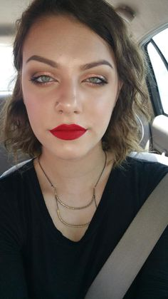 My favorite look to do - red lips, defined eye, and lots of highlighter.