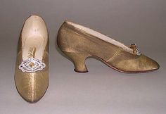 Gold lamé evening slippers with rhinestone buckles, by J&J Slater, American, ca. 1900.