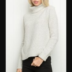 Brandy Melville cassia turtleneck sweater Cozy and comfy. Material is 10% wool 30% cotton 40% acrylic 17% poly 3% spandex. Not itchy. Selling cause I have too many sweaters. Flaw is one dot on bottom of a sleeve, as shown. Slight pilling. No trades please. Brandy Melville Sweaters Cowl & Turtlenecks