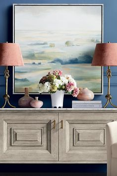 Hazy shades of blush, green and blue convey the quiet calm of a bucolic view. The lightness of the scene is accented by a hand-textured finish, embellished in gold.