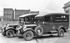 A Pair of 1928 Packard 443 Panel Trucks
