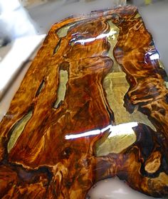 Ancient Kauri table top. Sanded and filled with Epoxy. Kauri is the oldest workable wood in the world, 50,000 years old. Sold out of Ashland, Wisconsin. Find it at www.ancientwood.com