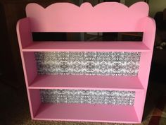Grabbed this shelf out of the trash was ugly and unpainted! Could go get a cheap shelf from thrift store too! Got some Clearance paint from Walmart (pink) then grabbed the five dollar roll of zebra shelf liner and place it on the back. This is a great idea for girls room. Also different style shelf liner could do in any room!!! The point was under $10 for this ;)