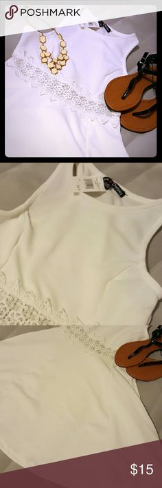 Summer dress for grabs! Beautiful white dress. It has lace across the middle and the dress fits best with wedges or open toe shoes sandles. Perfect for any event. No trades Dresses Midi