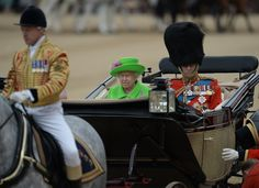 Britain's Queen Elizabeth II and Britain's Prince Philip, Duke of Edinburgh (R) arrive in a horse-drawn carriage at Horse Guards Parade for the Queen's Birthday Parade, 'Trooping the Colour', in London on June 11, 2016. .Trooping The Colour and the fly-past are part of a weekend of events to celebrate the Queen's 90th birthday. / AFP / OLI SCARFF