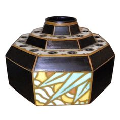 Charles Catteau Octagon  Stepped  Art Deco Vase, Belgium c. 1930s. Dynamic stepped up design, fabulous Deco detailing...and a series of small holes that can be perceived as just a part of the pattern. Rendered in a beautiful matte finish with alternating solid and patterned panels.
