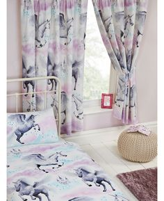 Enchanting Stardust Unicorn Purple and Teal Lined Curtains featuring unicorns and fairy castles and come complete with tie backs. Matching bedding and free UK delivery available.