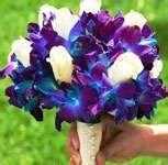 Blue dendrobium orchids and white rose bouquet. $125.00, via Etsy.