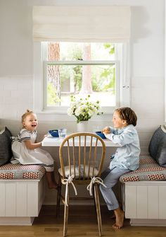 brother and sister laughing at kitchen booth table with white bouquet of flowers | Jenni Kayne's #RipAndTan