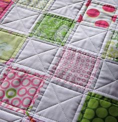 I like the quilting on this. It makes a simple pattern look much more complicated.
