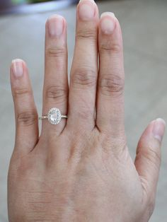 14K yellow gold diamond engagement ring featuring an oval cut natural diamond measuring 5.2 x 7 mm, and weighing approximately 0.70 ct. (G/H,SI). Very eye-clean stone, white, amazing cut, super sparkly! This beautiful oval diamond is flanked and surrounded by round brilliant cut diamonds with a total carat weight of 0.32 ct. (F-G, VS2-SI) Original STUDIO 1040 design. All handmade. ALL diamonds are conflict free, never enhanced. Size 6, can be sized. Additional charges apply on sizes 8…