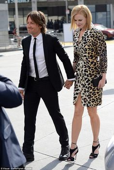 Wild thing: Nicole Kidman stood out in an animal print dress as she arrived at the American Idol XIV finale with husband Keith Urban at the Dolby Theatre in Hollywood on Wednesday  R