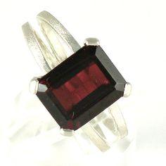 Garnet Engagement Ring, Garnet Sterling Silver Ring, Burgundy  Jewelry, Garnet Ring, Emerald Cut Silver Ring, January Birthstone. $76.00, via Etsy.