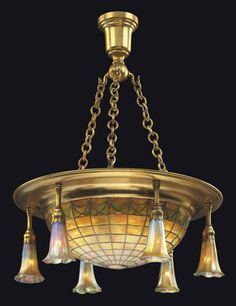 TIFFANY STUDIOS A Leaded Glass and Gilt-Bronze Chandelier, circa 1906 with six 'lily' shades 20 in.) diameter each lily engraved L. Bronze Chandelier, Antique Chandelier, Antique Lamps, Chandelier Lamp, Antique Lighting, Tiffany Chandelier, Chandelier Ideas, Chandeliers, Tiffany Art