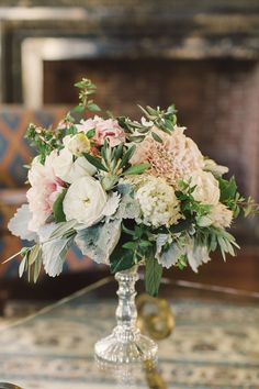 """Arlene Boyle says of this wedding, """"I love this trend of bouquets and centerpieces relating to each other but not being identical."""" Floral design by Violetta."""