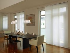 Summer is here, with its long, glorious days. Now is the perfect time to address those beautiful wide windows. You've left them bare to keep the panoramic views and flood of light intact, but you pay for that decision in air conditioning bills and faded decor.