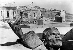 A destroyed monument of Lenin is pictured in front of ruins in Sevastopol on the Crimean Peninsula, July 1942.