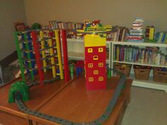 Lego Duplo elevated train track with skyscraper and roof-top playground
