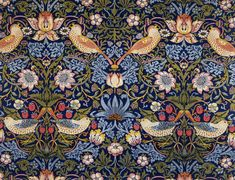 """Textile, by William Morris  V   The symmetrical, interlocking design of this indigo discharge and block-printed furniture fabric combines favourite Morris themes of flora and fauna. Pairs of thrushes sit amongst classical acanthus leaves, scrolling pink and white flowers and strawberries, all coming together to lend the fabric its charming name: """"The Strawberry Thief""""."""
