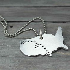 A necklace with your two locations on it, another great way to keep them close to your heart.