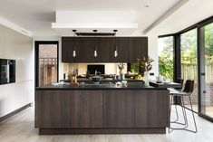 Modern handleless kitchen with an island | Family kitchen in London, UK  |   Kitchen by Elan Kitchens, 55 New King's Road, London, SW6 4SE.  Tel: 020 7384 0511  Email: info@elankitchens.co.uk Website: www.elankitchens.co.uk Hampstead London, Handleless Kitchen, Modern Kitchens, Family Kitchen, Island Design, Kitchen Island, Website, Table, Furniture
