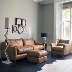 The Hugo Collection takes inspiration from the Gatsby era. Finished in the softest tan hide with solid walnut legs.
