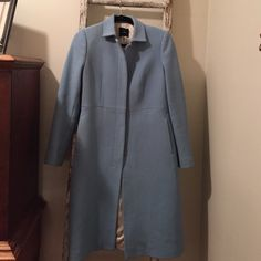 Beautiful JCrew wool coat This JCrew wool coat is gorgeous! It's a robins egg blue...almost a Tiffany blue color. There normal wear...a small spot on right elbow and a small stain on lining (as noted in photo. Otherwise in terrific condition for such a light color. Nonsmoking home! J. Crew Jackets & Coats Trench Coats