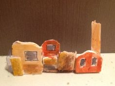 The City Landscape based on the Treasure Box by Margaret Wild. Materials used: balsa wood sheets; watercolour paints; acetate sheet; felt tip pen. This idea came from the Zart Art book Week PD.