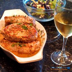 Sexy Pork Chops are smothered in a wonderful zesty sauce made of white wine, chicken broth, and garlic then finished off with lemon and fresh herbs. Pork Chop Recipes, Meat Recipes, Dinner Recipes, Cooking Recipes, Healthy Recipes, Dinner Ideas, Yummy Recipes, Pork Meals, Pork