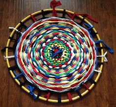 Repurpose a hula hoop...the instructions are for making a rug using old t-shirts...but this could also be an art project if yarn or twine is used instead...a student did just that in a high school arts & crafts class...it turned out really neat.