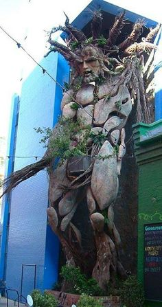 """A tall sculpture of a Green Man by """"Tawny Gray"""" (Toin Adams) at the Custard Factory, Birmingham, England. (The building was sold in let's hope they preserve this wonderful heroic-scale piece! Art Sculpture, Metal Sculptures, Abstract Sculpture, Bronze Sculpture, Crazy Funny, Fantasy, Pics Art, Tree Art, Public Art"""