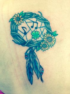 My design in my head put to paper then ink on my shoulder by an awesome tattoo artist... I am part Native American the sunflower is a favorite flower of mine . My dreamcatcher caught my boys.... The first music note my firstborn musical child, the clover is my middle son who is so special this is one of his traits being able to find one in any clover field he goes and it's of the earth like him, the last music note for my second musical child.... On my left shoulder the side your heart…