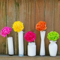 This easy-to-follow tutorial shows you how to make brightly colored tissue paper flowers.