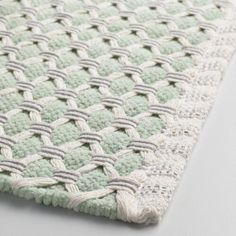 Give your bare feet a soft place to land with our cotton bath mat. It features an intricate basket-weave design in mint and gray with a solid vertical side border.