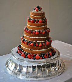 #naked #wedding #cake with fresh #berries #london #rustic #nude  Little Bear Cakery
