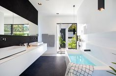 A Black & White Minimal Home In Australia: Doonan Glass House by Sarah Waller Design