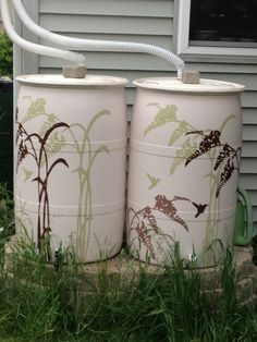 Rain Barrels painted with stencil and exterior house paint