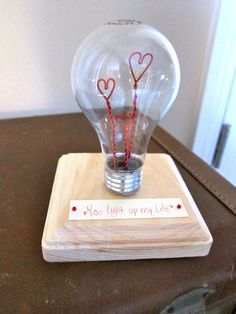DIY valentines day lightbulb. Take an old lightbulb an to move everything inside so your left with the glass bulb, then get some red (or whatever colour) wire and shape it into a heart (or anything else), the take a small wooden slab, make a little note on card and stick it into the wooden slab, then glue the light bulb and wire shapes to the bottom of the slab.