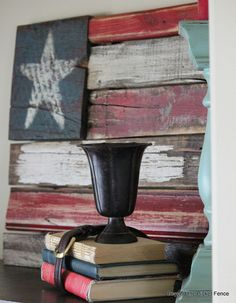 Beyond The Picket Fence: chippy, rustic version of Old Glory.  I love the black belt around the books.
