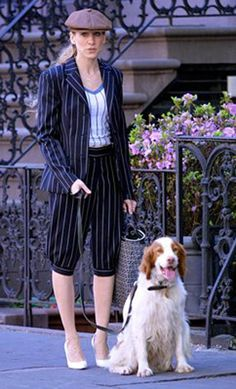 This is Carrie Bradshaw from Sex and the City. Her trousers look similar to knickerbockers worn during the period. They also feature pin stripes.